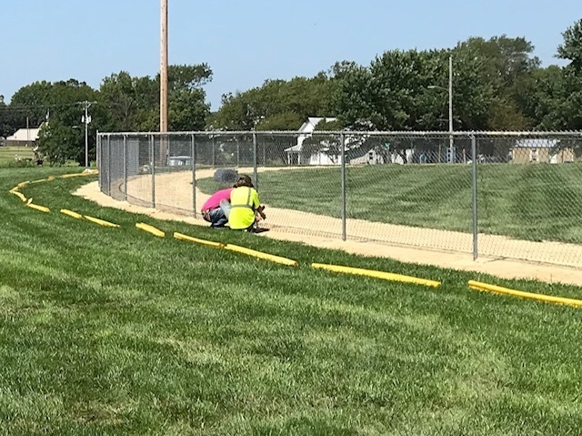 Workers installing fence